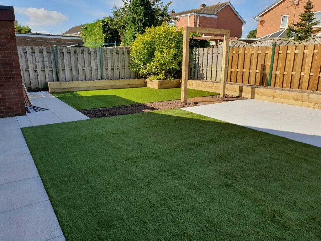 Two artificial lawns and porcelain patio
