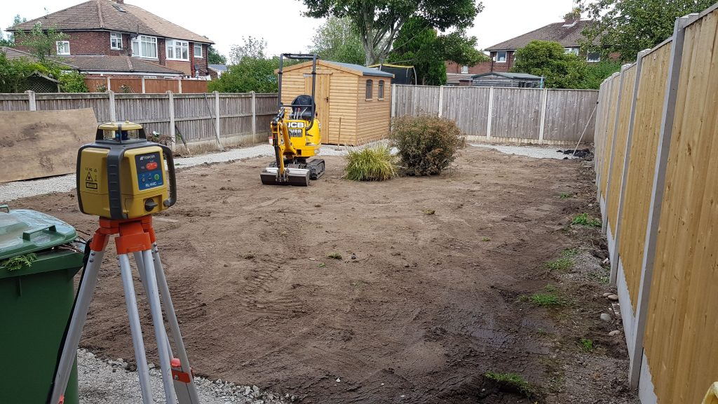 micro digger removing turf
