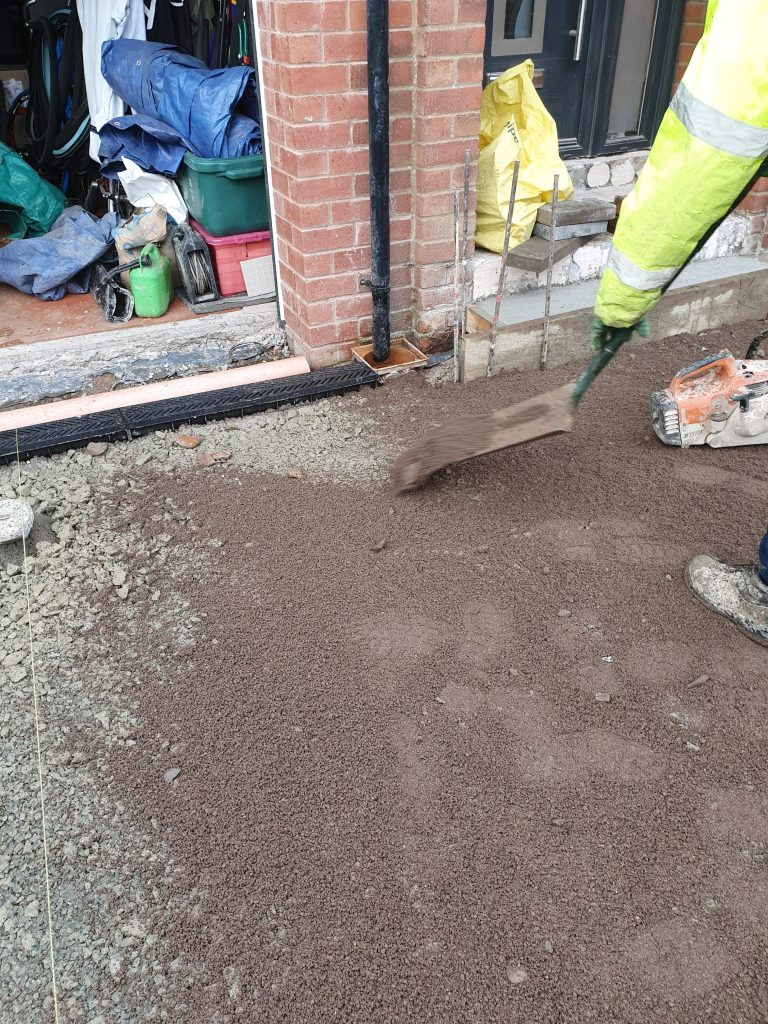 adding sand to blind the subbase