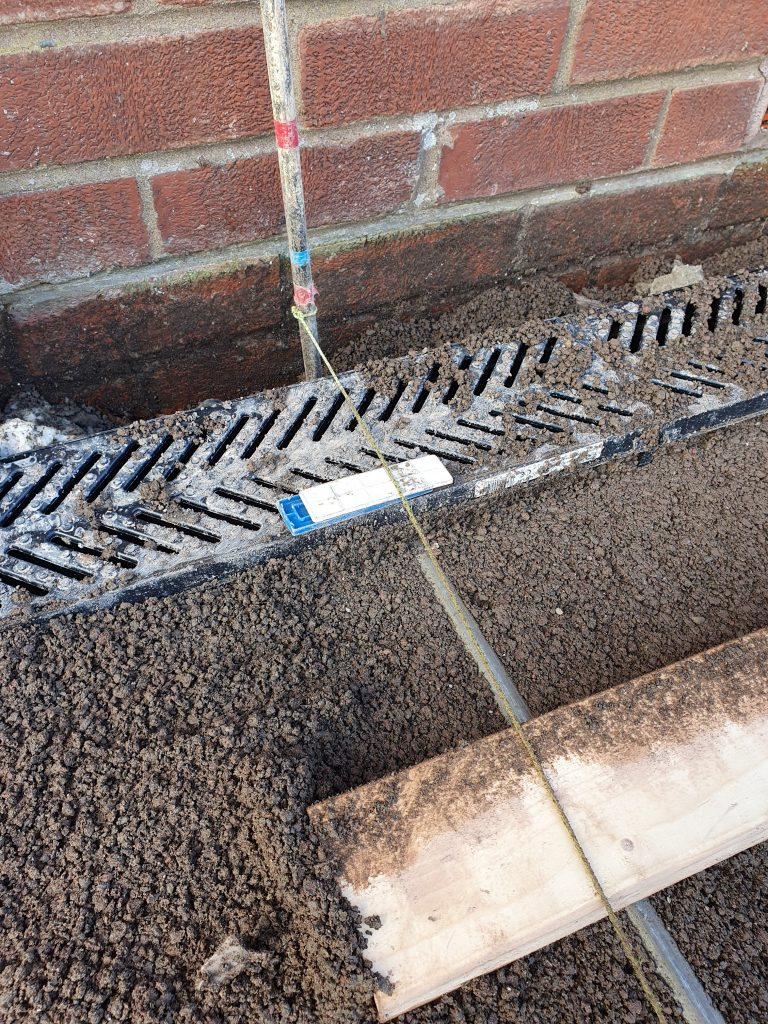 screed bars set beneath taught string line