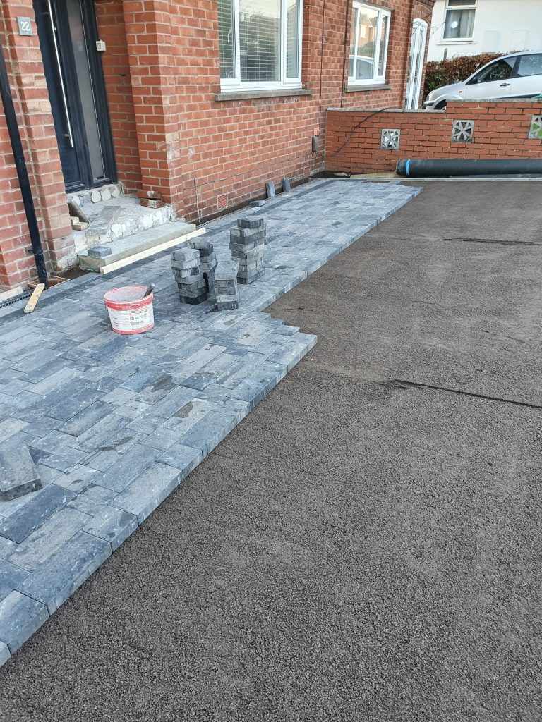 view of block paving being laid