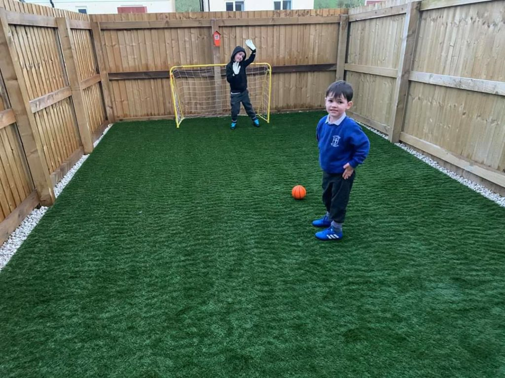children playing football on artificial lawn in carlisle