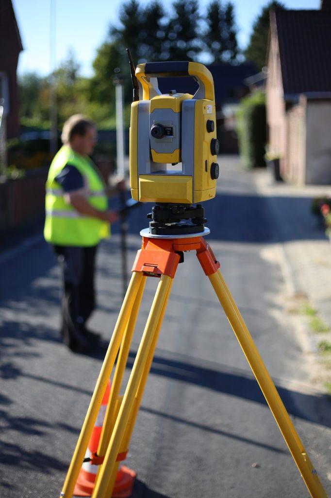 theodolite surveying a garden