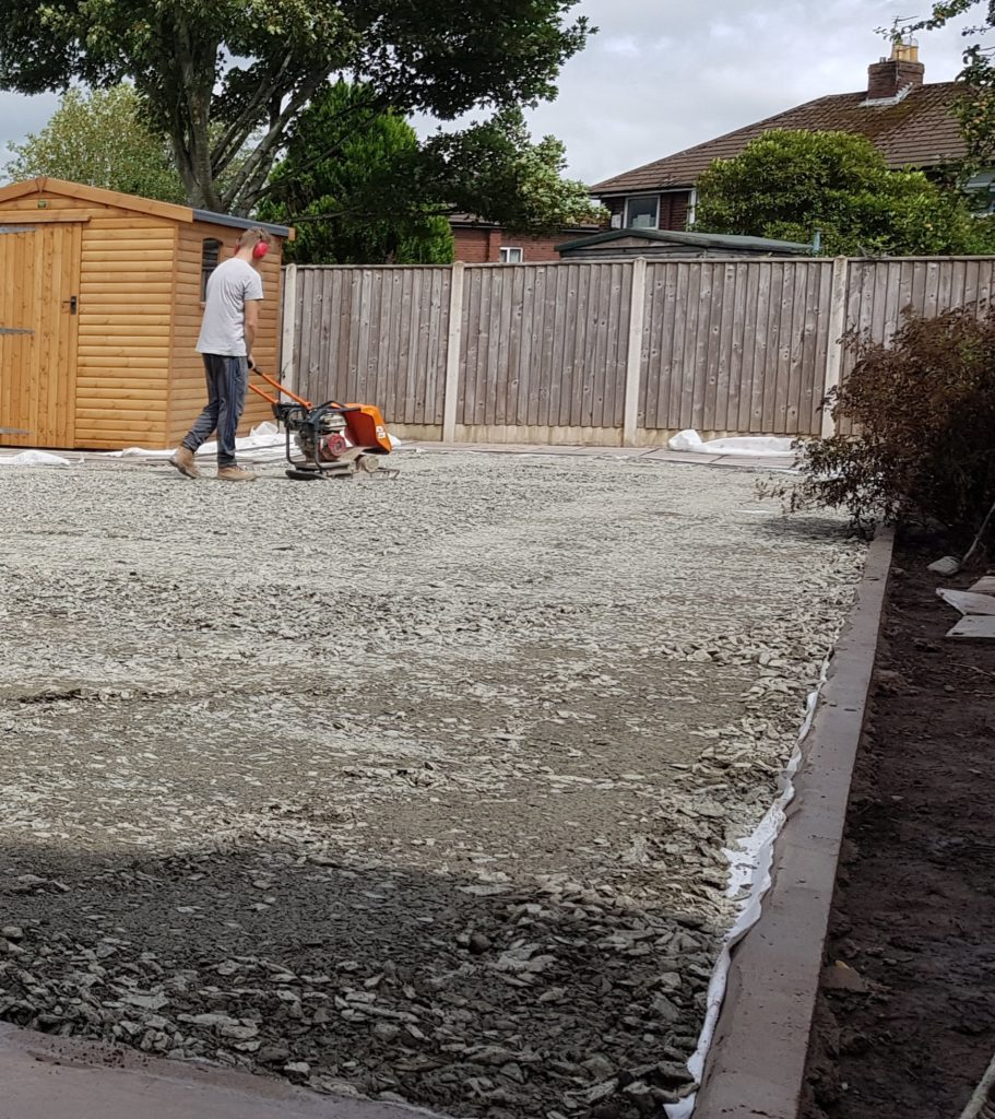 Subbase being compacted