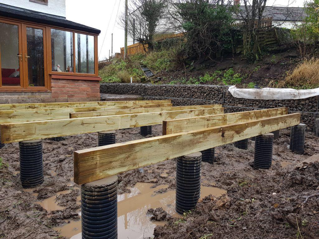 deck frame beams on footings