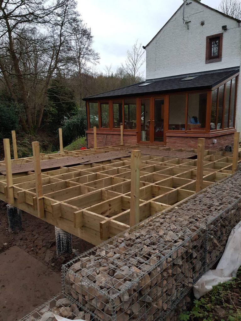 newel posts installed on decking frame