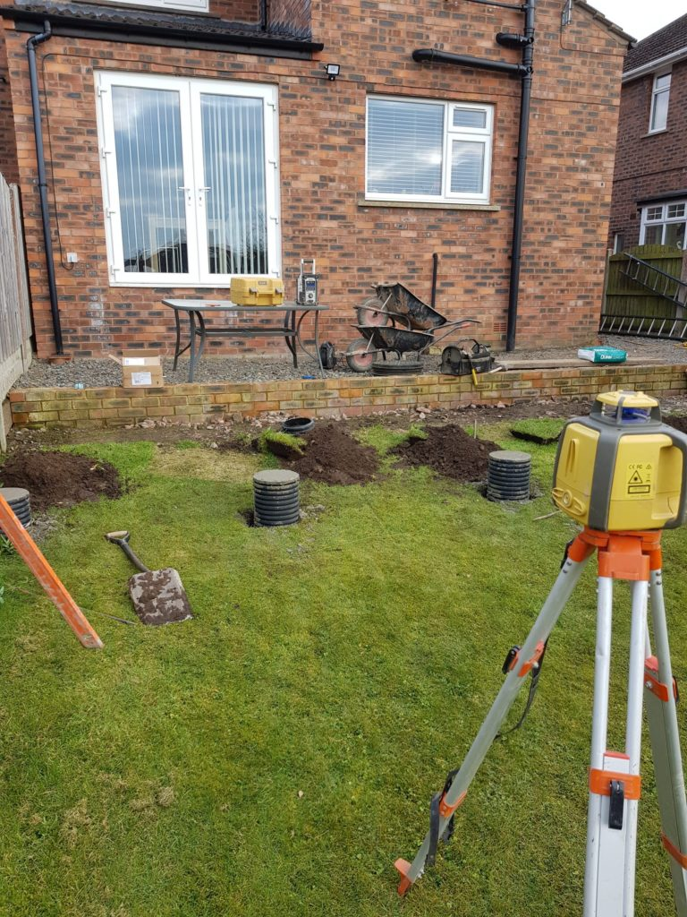 laser level used to set footings for decking Carlisle