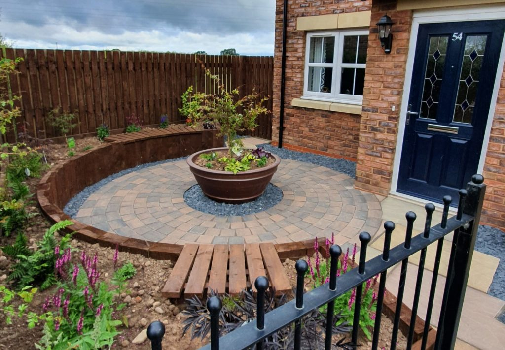 circular patio and ceramic pot with Acer centre