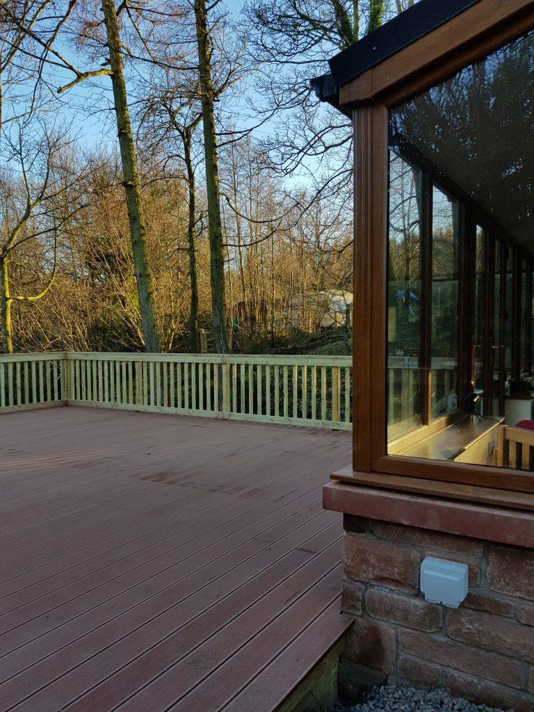 deck built against  a wall