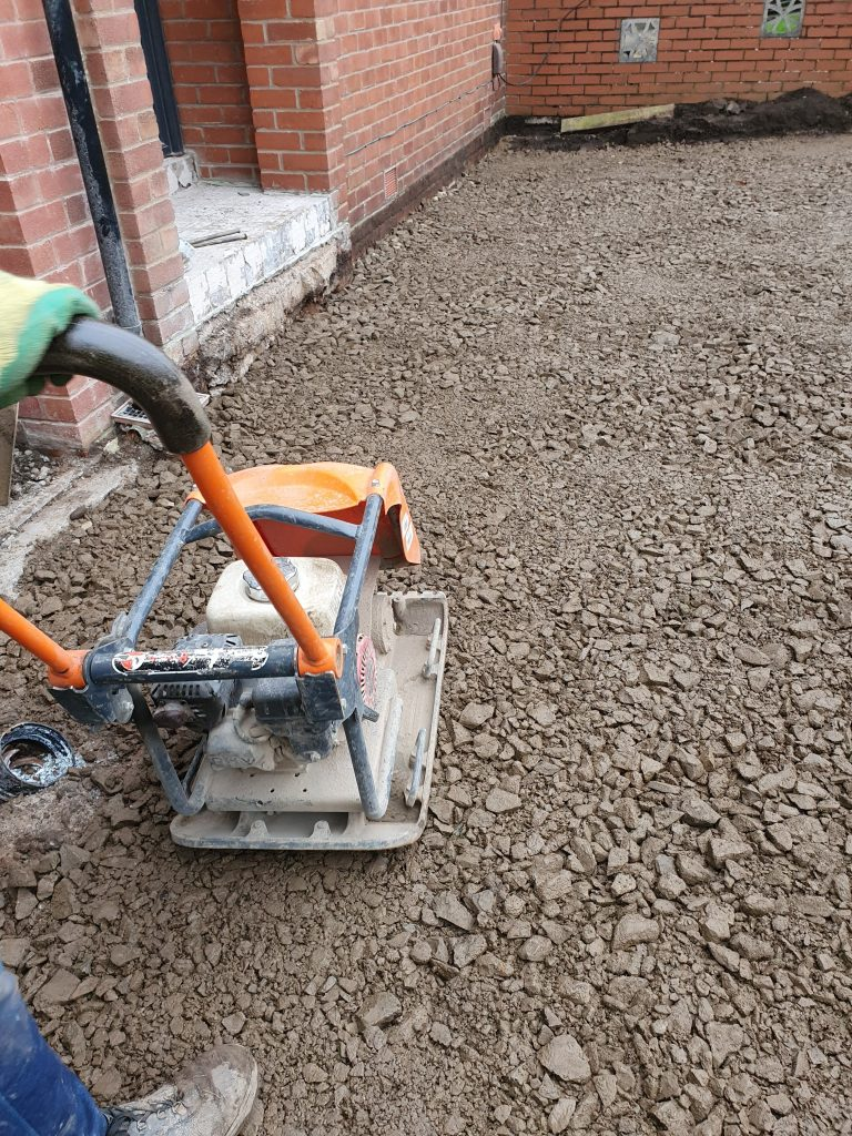 Plate compactor on the subbase material