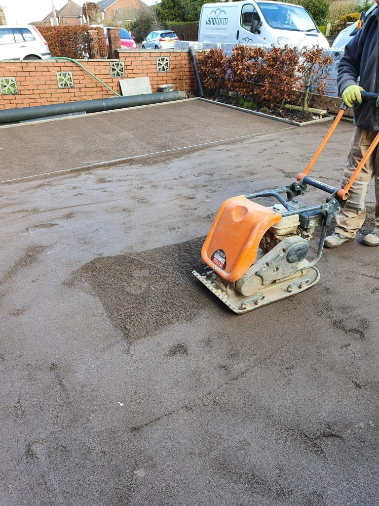 plate compactor compacting bedding sand