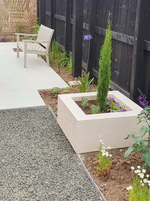 white rendered planters and black fence Carlisle landscaper