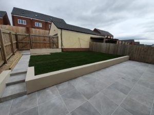 porcelain tiled patio paving and rendered garden wall