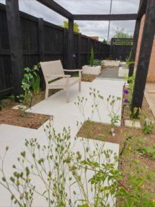 porcelain paving and pergola in contemporary garden